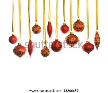 Red christmas balls with yellow stripes over white - stock photo