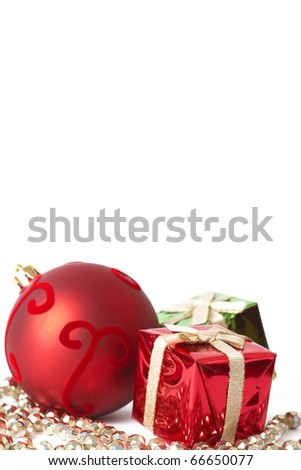 Red Christmas bauble and two gift boxes isolated on white background with copy space. - stock photo