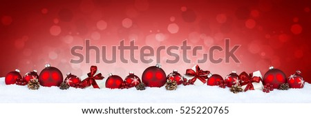red christmas bauble ball row with white xmas present gift boxes and pine cones on bokeh background