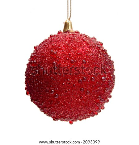 Red christmas bauble hanging in isolation
