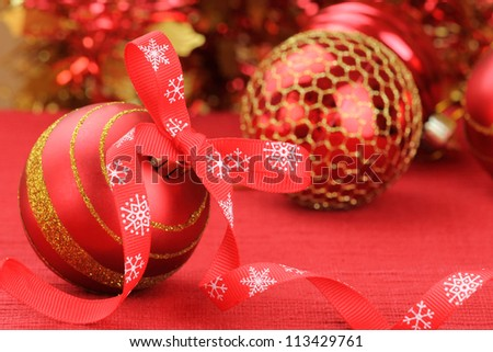 Red Christmas bauble with a decorative bow