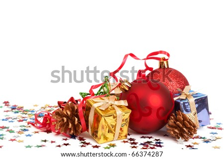 Red Christmas baubles and other decorations isolated on white background with copy space. - stock photo