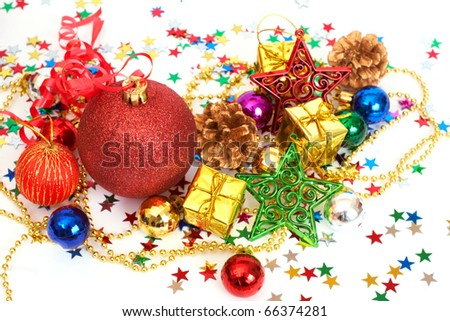 Red Christmas baubles and other decorations with stars on white background with copy space - stock photo