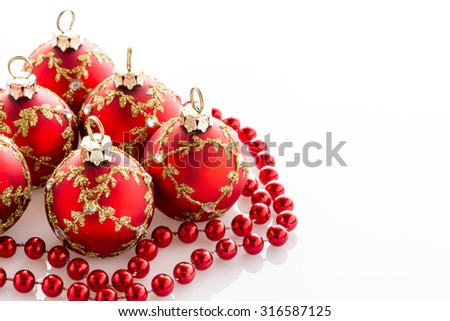Red Christmas baubles and ribbon. Isolated on white background - stock photo