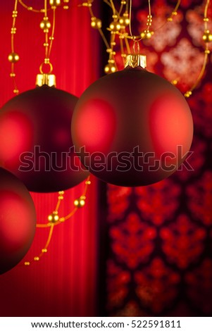Red Christmas baubles on abstract background