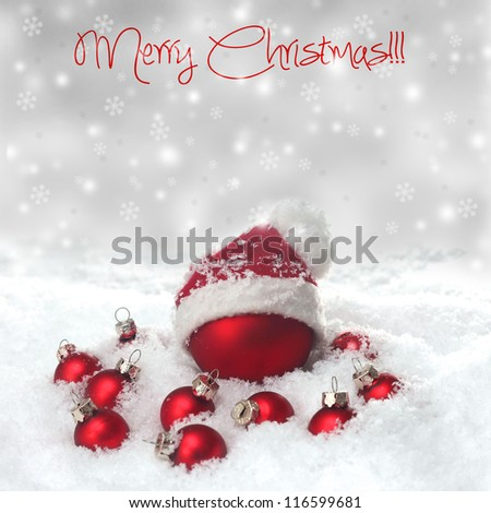 Red christmas baubles on the snow - stock photo