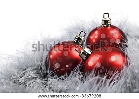 Red christmas baubles on white background - stock photo