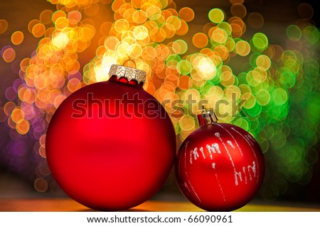 Red Christmas baubles with  golden lights on background.