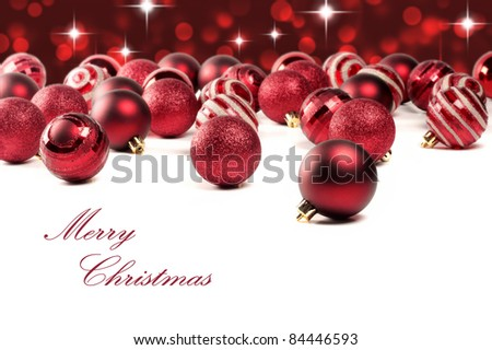 Red Christmas baubles with lights blurred in background. Shallow DOF. - stock photo