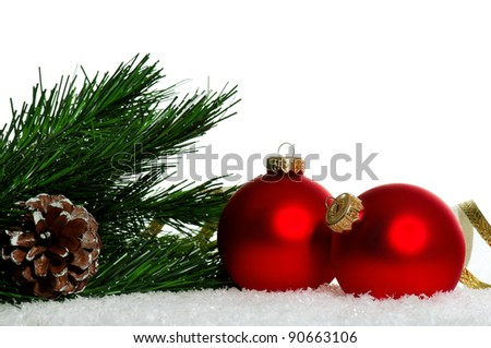 Red christmas baubles with snow on white background