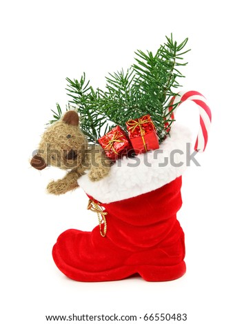 Red christmas boot with gift boxes and teddy bear isolated on white background