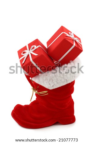 Red Christmas boot with gifts isolated on white background - stock photo