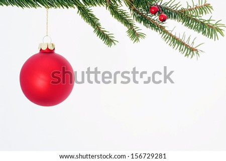 Red Christmas Bulb Hanging From Tree - stock photo