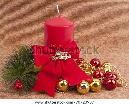 red Christmas candle and bauble - stock photo