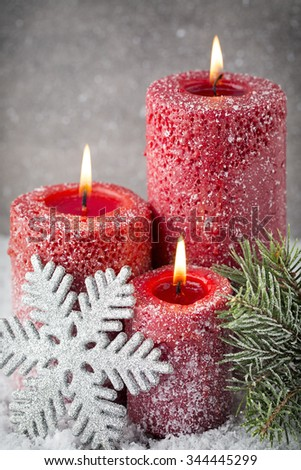 Red christmas candles and lights. Christmas background.