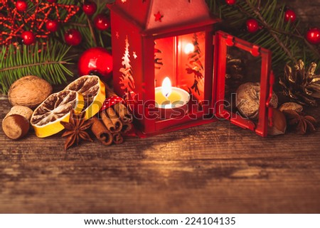 Red christmas candlestick and flavours of holidays - stock photo