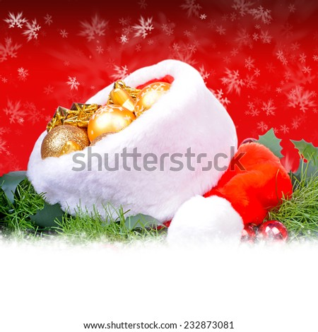 Red christmas card with red Santa Claus hat - stock photo