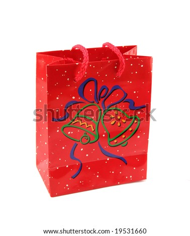 Red Christmas carry bag with red rope handles. - stock photo