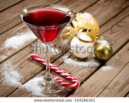 Red Christmas cocktail with balls and snow - stock photo