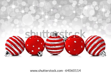Red christmas decoration balls on a star background with space for text - stock photo