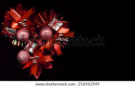 Red Christmas decoration on a black background - stock photo