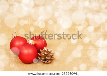 Red Christmas Decoration on a bokeh background with copyspace for text