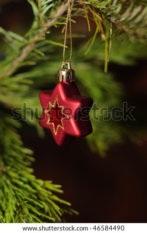 red christmas decoration on fir - stock photo
