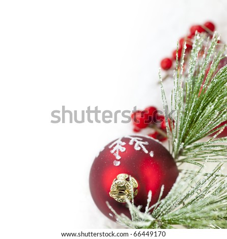 Red Christmas decoration with pine needles with copy space - stock photo