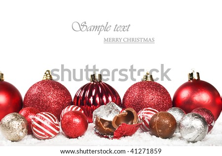 Red christmas decorations and chocolates - stock photo