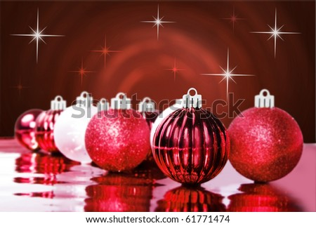 Red christmas decorations on a red star background