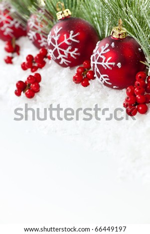 Red Christmas decorations with pine branches with copy space - stock photo