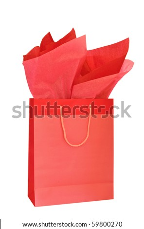Red Christmas gift bag with tissue paper isolated on white background - stock photo