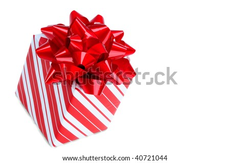 Red Christmas Gift Wrapped In Striped Wrapping Paper, Isolated On A White Background With Copy Space
