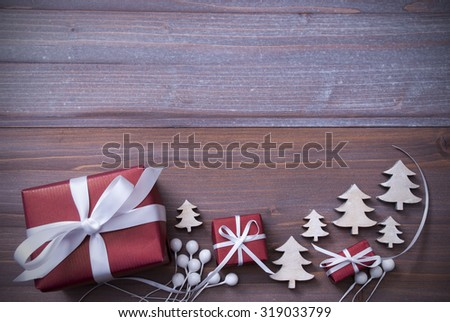 Red Christmas Gifts, Presents, White Ribbon With Christmas Trees As Decoration. Shabby Chic, Rustic, Vintage Wooden Background. Copy Space For Advertisement. Card For Birthday Greetings - stock photo