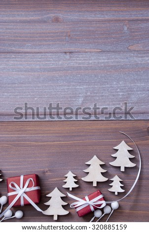 Red Christmas Gifts, Presents, White Ribbon With Christmas Trees As Decoration. Vintage, Rustic, Wooden Background. Copy Space For Advertisement. Card For Birthday Greetings. Vertical Image - stock photo