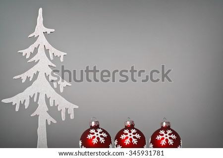 Red christmas glitter-balls and a white christmas tree - stock photo