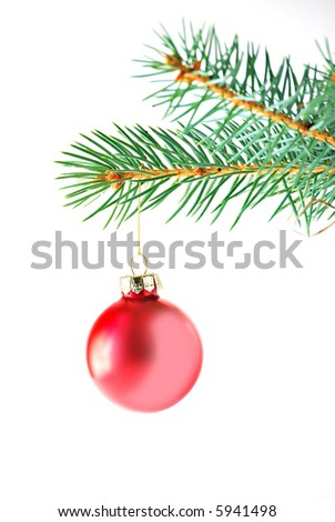 red christmas ornament hanging from a spruce branch