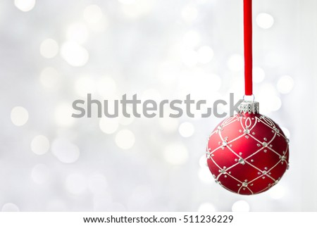 Red Christmas ornament with copyspace to side