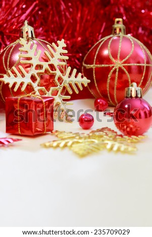 red christmas ornament with gift, ribbon on gold twinkle paper background