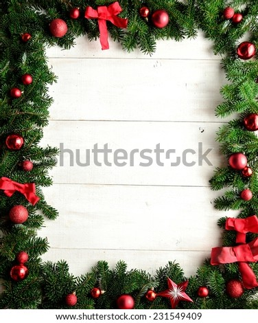 Red Christmas ornaments of fir leaves.frame.Image of Christmas. - stock photo