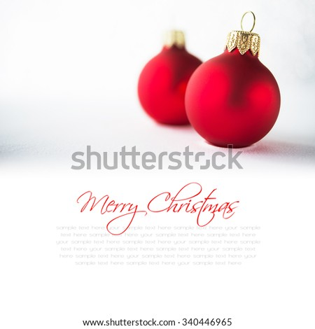 Red christmas ornaments on glitter holiday background. Winter holidays. Xmas theme. Space for text. Happy New Year. - stock photo