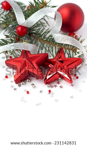 Red christmas ornaments on white background with space for text. Merry christmas card. Winter holidays. Xmas theme. - stock photo