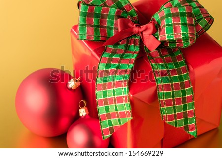 Red Christmas present and decorations big bow gift card - stock photo