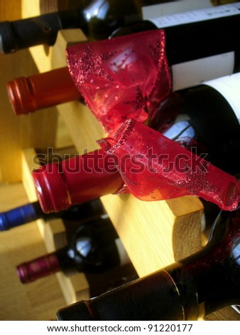 Red christmas ribbon on a wine bottle