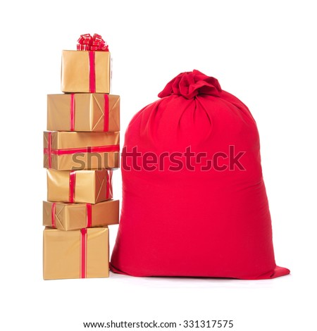 Red Christmas sack full of and surrounded by wrapped gift boxes, isolated on a white background. - stock photo