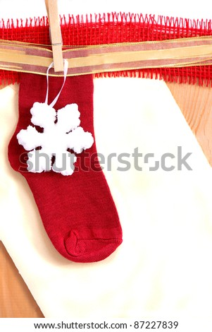 Red christmas sock and paper with place for text
