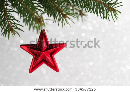 Red christmas stars on the xmas tree on glitter bokeh background. Merry christmas card. Winter holidays. Xmas theme. Happy New Year. - stock photo