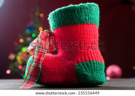 Red christmas stocking a holiday ornament - stock photo