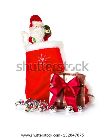 Red Christmas stocking and Santa Claus, Saint Nicholas, holiday ornament - stock photo
