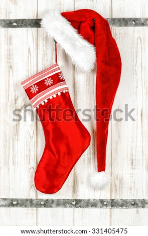 Red christmas stocking. Retro style decoration on bright wooden background. Christmas decoration